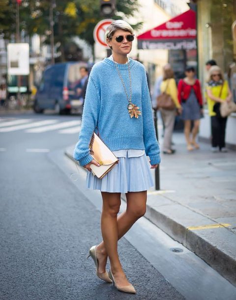 With light blue sweatshirt, skater skirt and metallic clutch