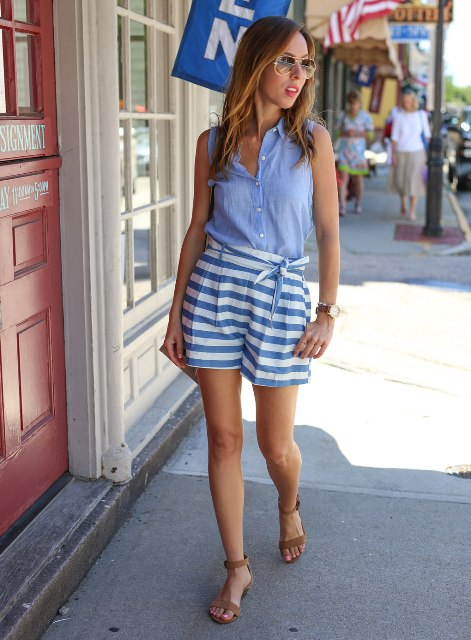 With light blue top and beige sandals