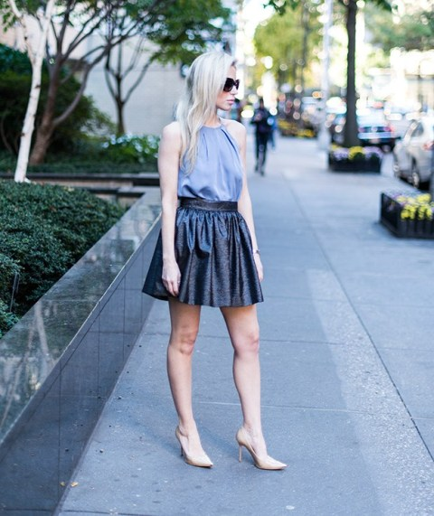With metallic mini skirt and nude pumps