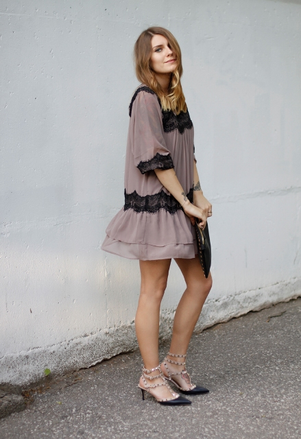 With mini dress and black clutch