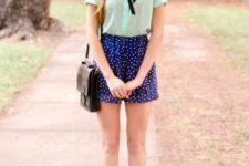 With mint blouse, black mini bag and platform shoes