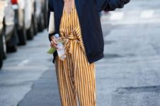 With navy blue bomber jacket and black flats