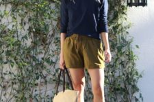 With navy blue loose shirt, sandals, hat and beige tote