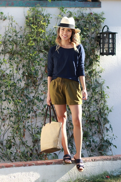 Picture Of With navy blue loose shirt sandals hat and beige tote