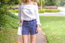 With off the shoulder blouse, white bag and sandals