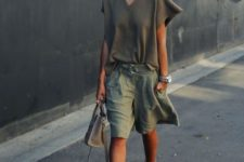 With olive green loose blouse, heels and gray bag