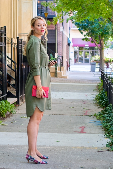 With olive green shirtdress and red clutch