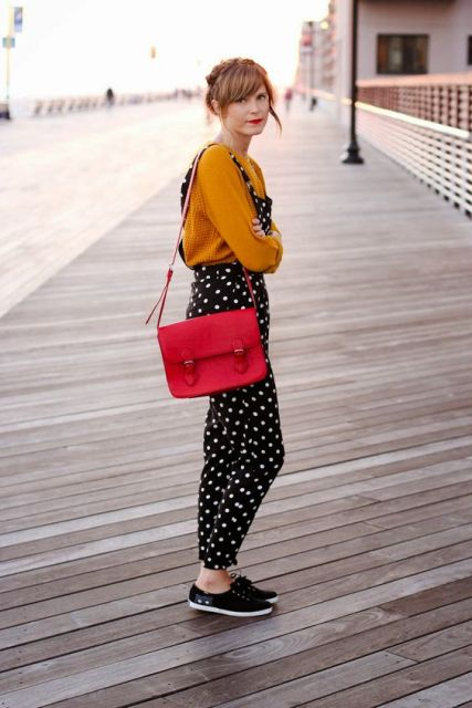 With orange shirt, red bag and black shoes