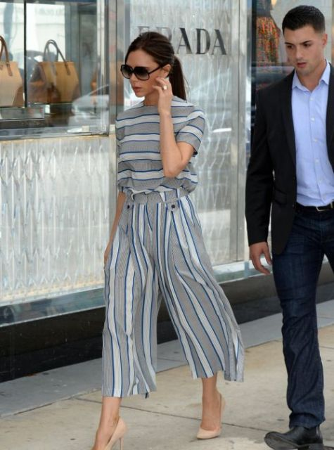 With oversized sunglasses and beige pumps
