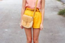 With pale pink blouse, brown belt, brown flats and two color bag