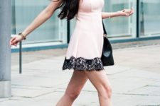 With pale pink mini dress with black lace