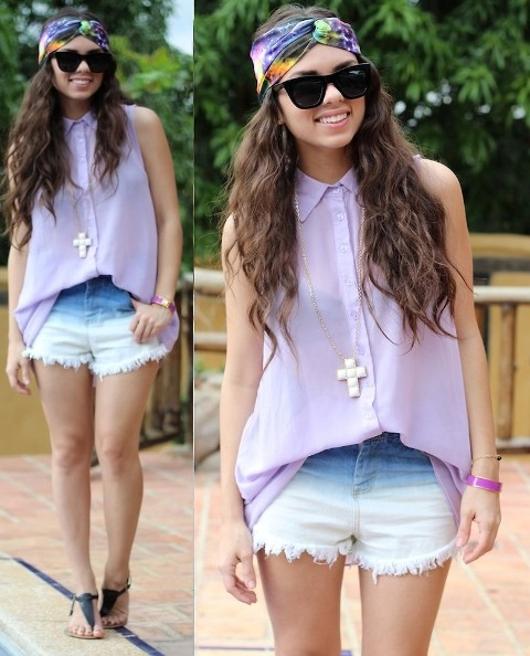 With pastel color shirt and black sandals