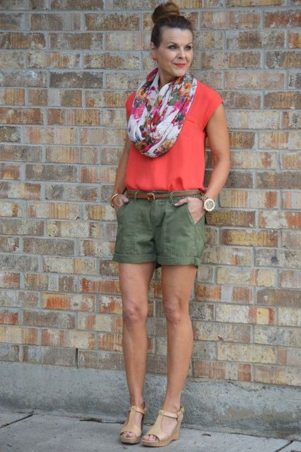With pink shirt, printed scarf and beige sandals