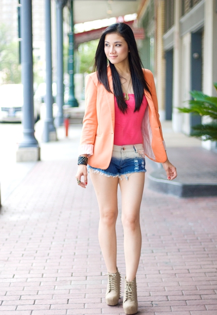 With pink top, peach blazer and gray boots