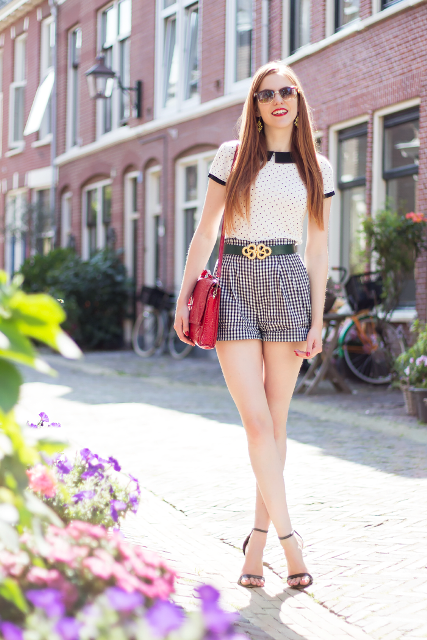 With polka dot shirt, red bag and black heels