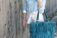With printed blouse, turquoise bag and sandals
