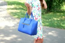 With printed dress and blue bag