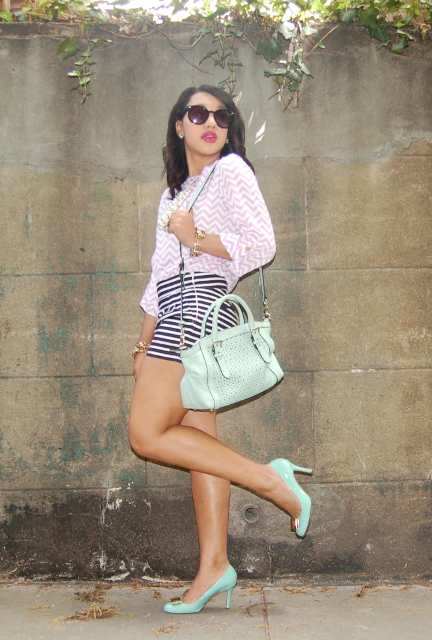 With printed shirt, mint green bag and pumps