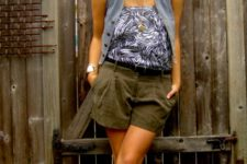 With printed top, gray vest and metallic flat sandals