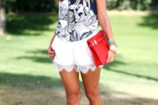 With printed topm red clutch and lace up sandals
