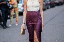 With purple midi skirt, lace up sandals and clutch