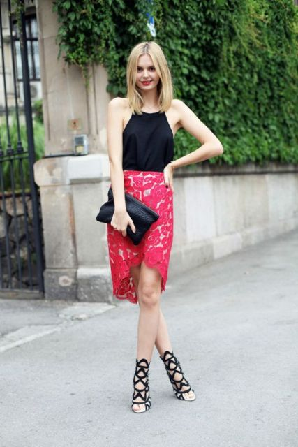 With red lace skirt, lace up shoes and black clutch