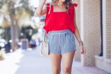 With red ruffled top, straw hat, white bag and heels