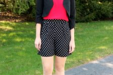 With red shirt, black blazer and white pumps