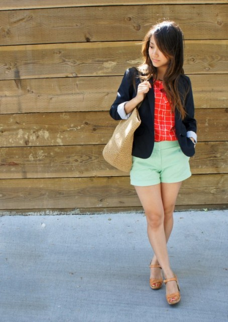 With red shirt, navy blue blazer, beige tote and sandals