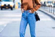 With silk shirt and cuffed jeans