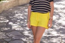 With striped shirt and nude flats