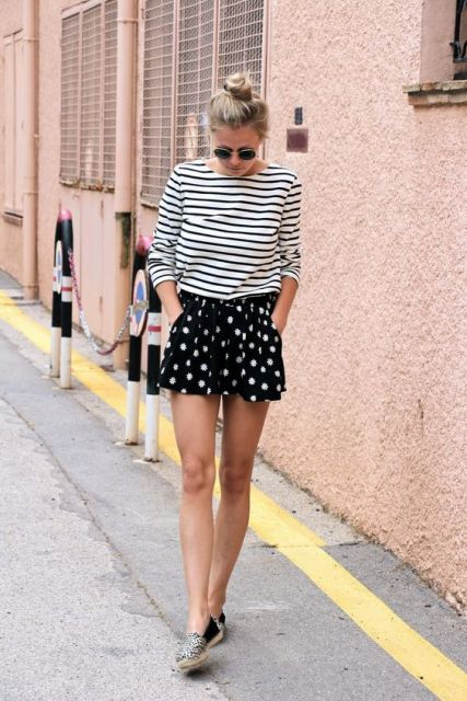 With striped shirt and printed moccasins