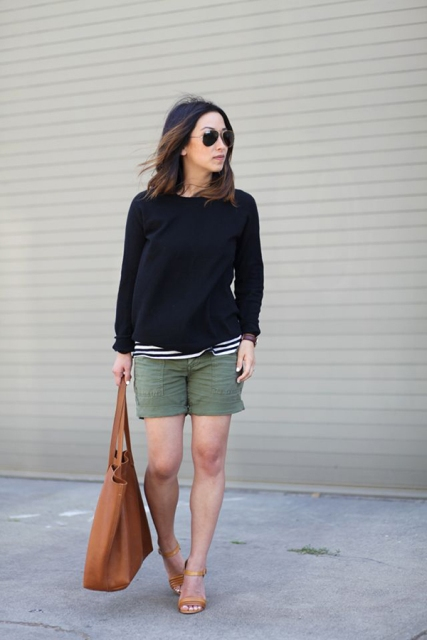 With striped shirt, black sweatshirt, beige sandals and brown tote