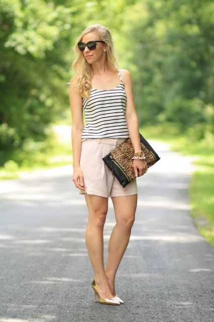 With striped top, leopard clutch and golden pumps