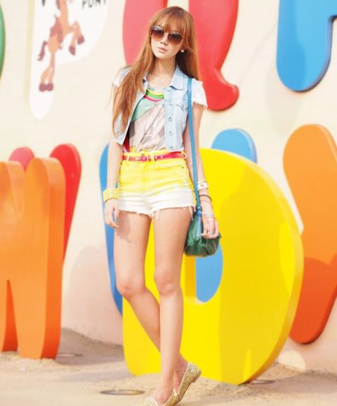 With t-shirt, denim vest, green bag and golden flats