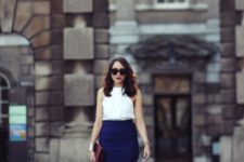 With white and blue skirt, heels and clutch
