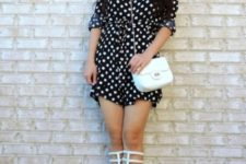 With white bag and gladiator shoes