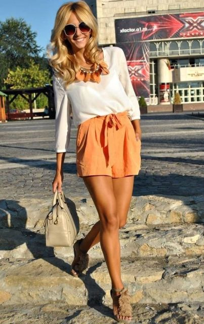 With white blouse, beige sandals and beige bag