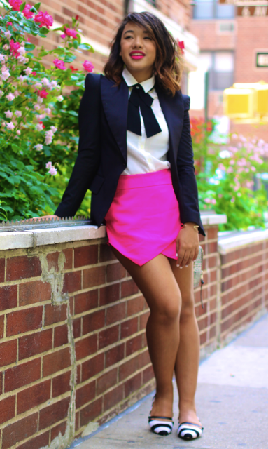 With white blouse, black tie, navy blue jacket and printed flats