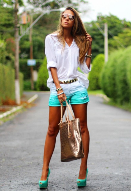 With white blouse, golden belt, high heels and metallic tote