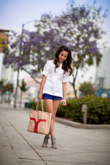With white blouse, gray cutout boots and tote