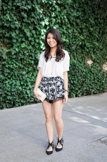 With white blouse, white clutch and black flats