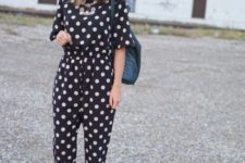With white boots and black bag