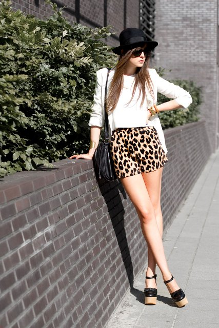 With white crop top, white blazer, black bag and platform shoes
