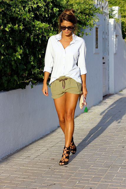 With white loose shirt and black lace up heels