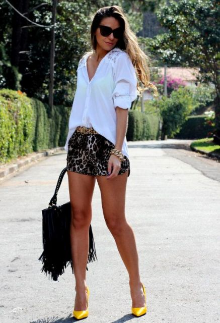 With white loose shirt, black bag and yellow pumps