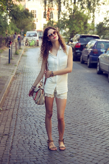 With white shirt, animal printed sandals and beige bag