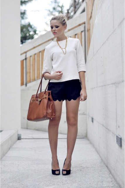 With white shirt, black heels and brown bag