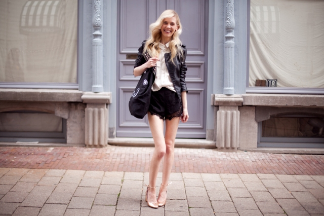 With white shirt, black leather jacket, black tote and metallic heels