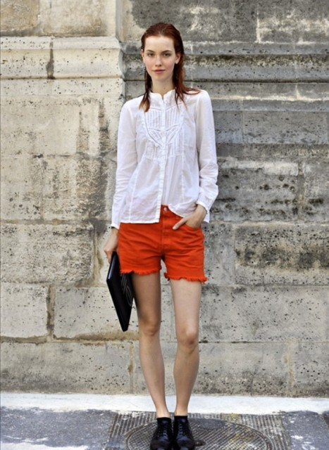 With white shirt, black shoes and black clutch